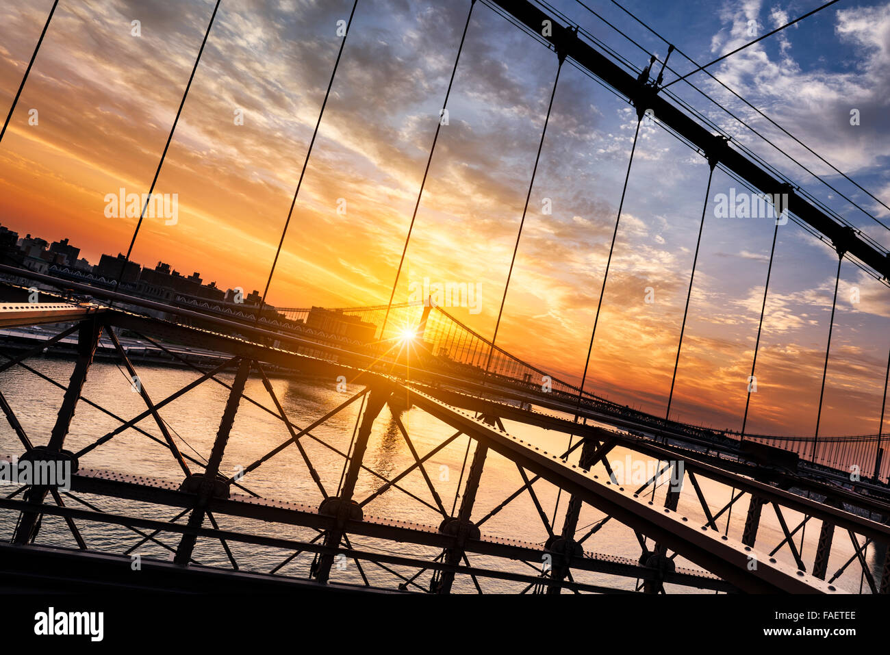 New York City, USA, early in the morning from the famous Brooklyn Bridge, view on Manhattan bridge - Stock Image