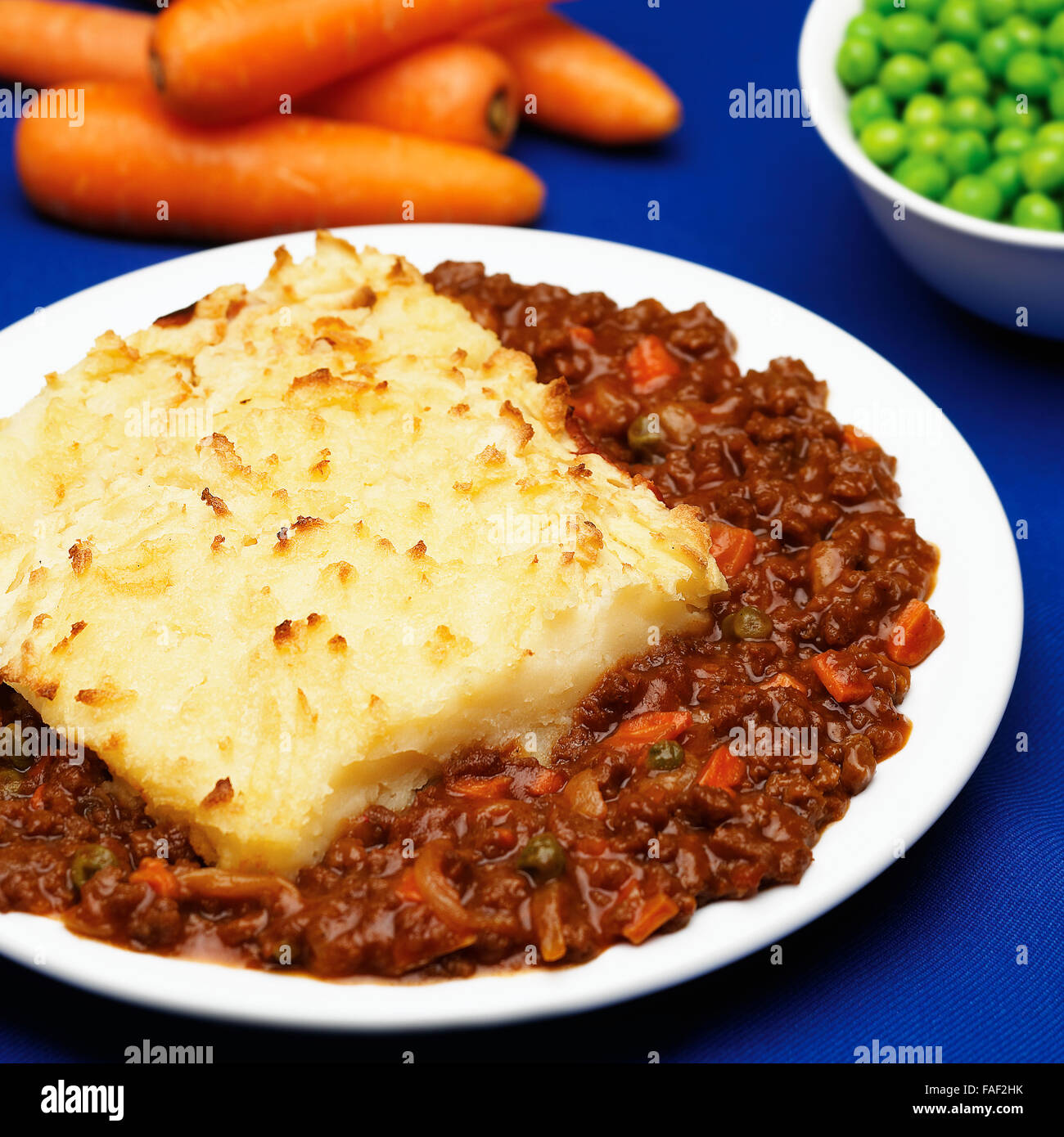 Plate of homemade shepherd\u0027s pie made with minced beef garden peas carrots and a baked mashed potato topping. & Plate of homemade shepherd\u0027s pie made with minced beef garden peas ...