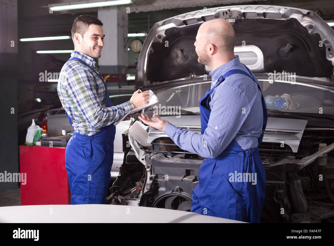 Car Repair Insurance >> Happy Insurance Agent And Professional Mechanic Indoors In