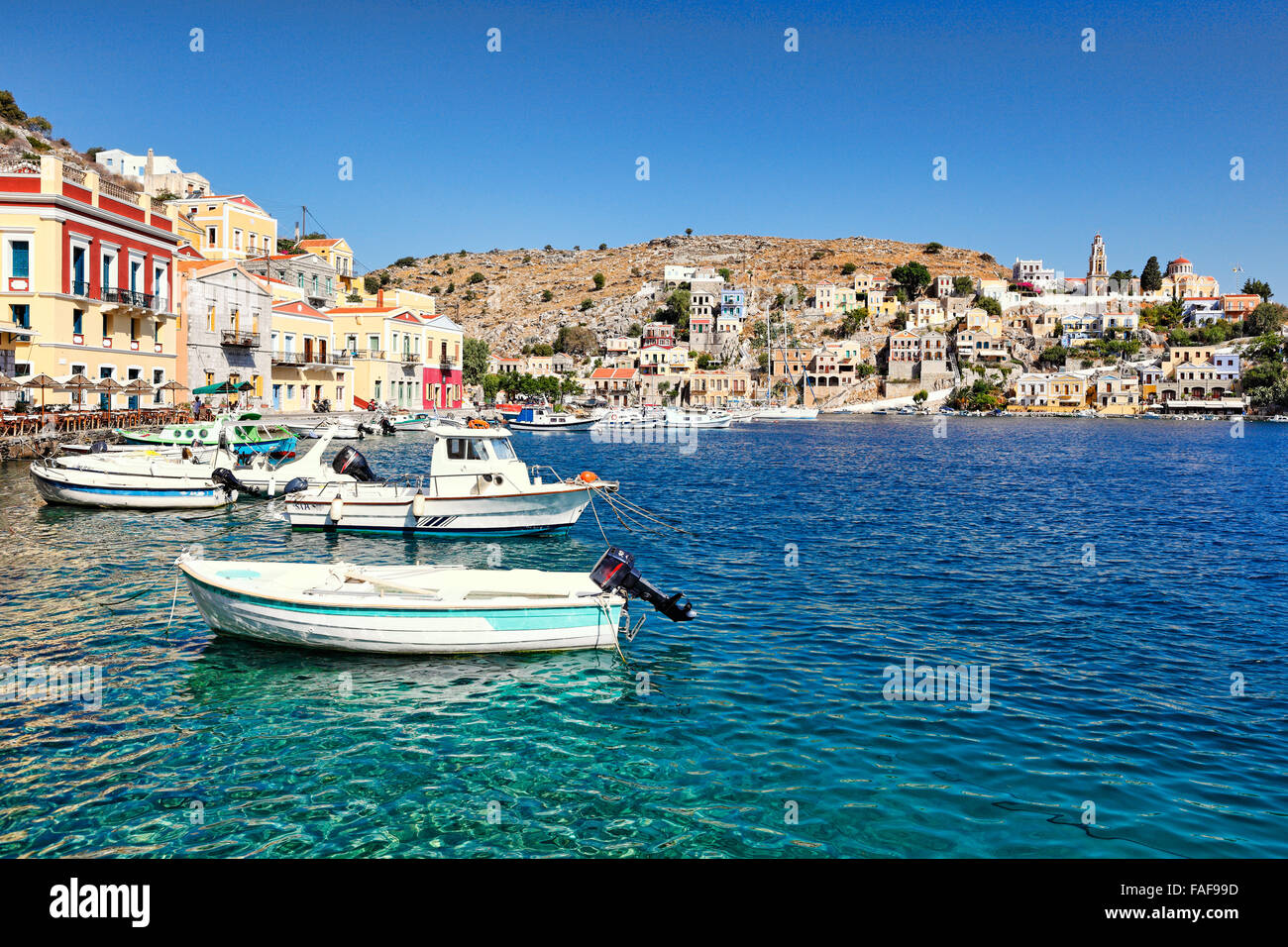 Fishing boats at the port of Symi island, Greece - Stock Image