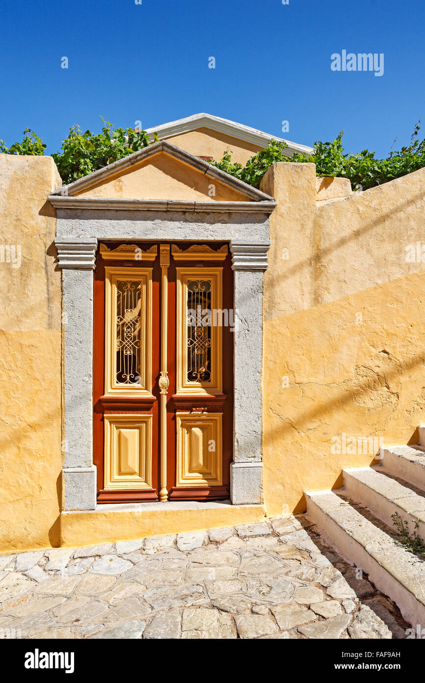 Old door of a mansion at the upper town (Chorio) of Symi island, Greece - Stock Image