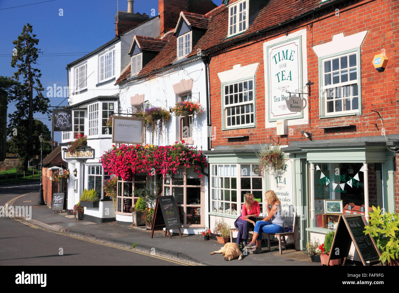 Enjoying the autumn sunshine outside a tea shop at Castle Hill, Kenilworth, Warwickshire. Stock Photo