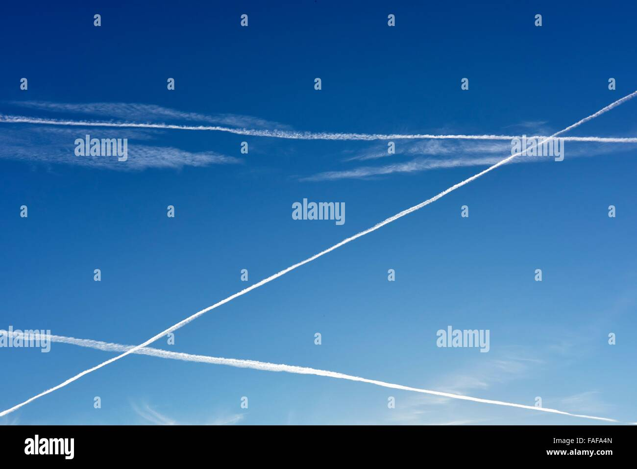 Contrails of airplanes in the sky, Bavaria, Germany - Stock Image