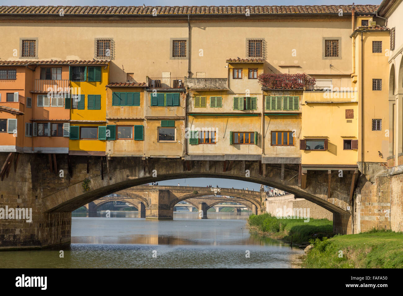 Ponte Vecchio and Arno River, behind other Bridges, Florence, Tuscany, Italy - Stock Image