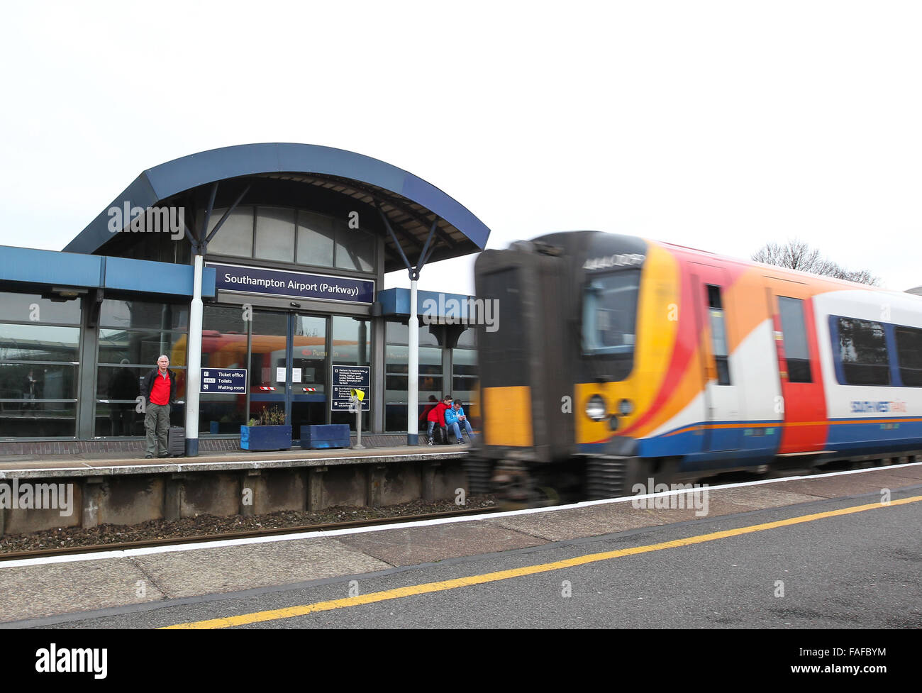 A South west Train arriving at Southampton Airport Parkway railway station next to Southampton Airport - Stock Image