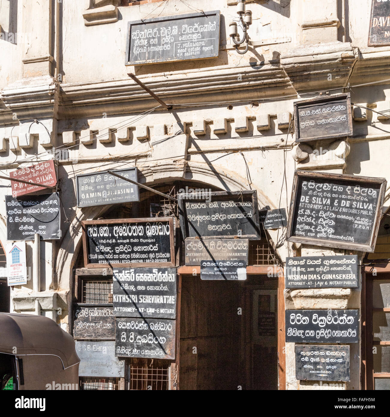 Placards denoting offices of attorneys and notaries on Deva St near the Temple of the Tooth in Kandy, Sri Lanka - Stock Image