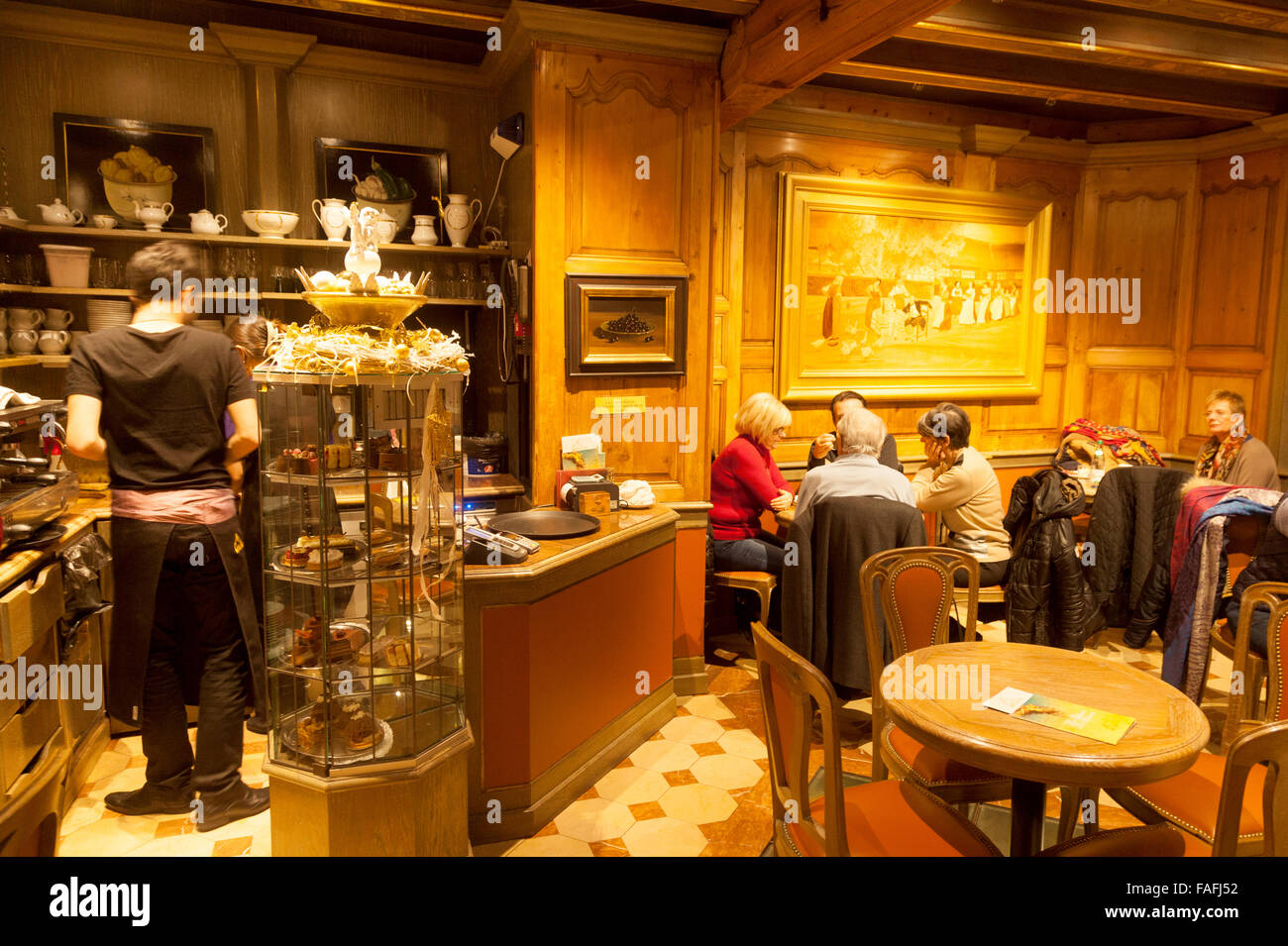 Waiter and customers in the interior of Christian Salon de The ( Tea rooms ), Rue Merciere, Strasbourg, France Europe - Stock Image