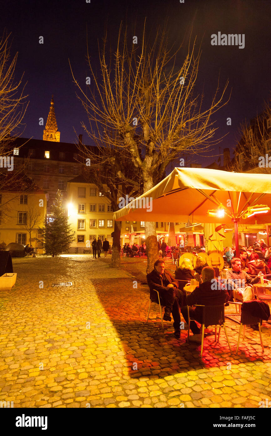 People sitting outdoors at a cafe at night, Place du Marche Gayot, Strasbourg Old Town, Alsace, France Europe (See Stock Photo
