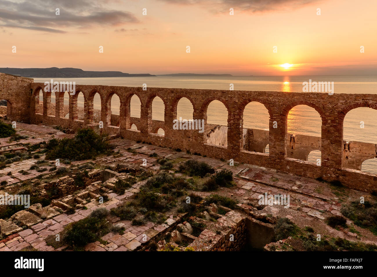 Ruins of industrial mining along the west coast of Sardinia. Panorama at sunset. The Marmora washery. - Stock Image