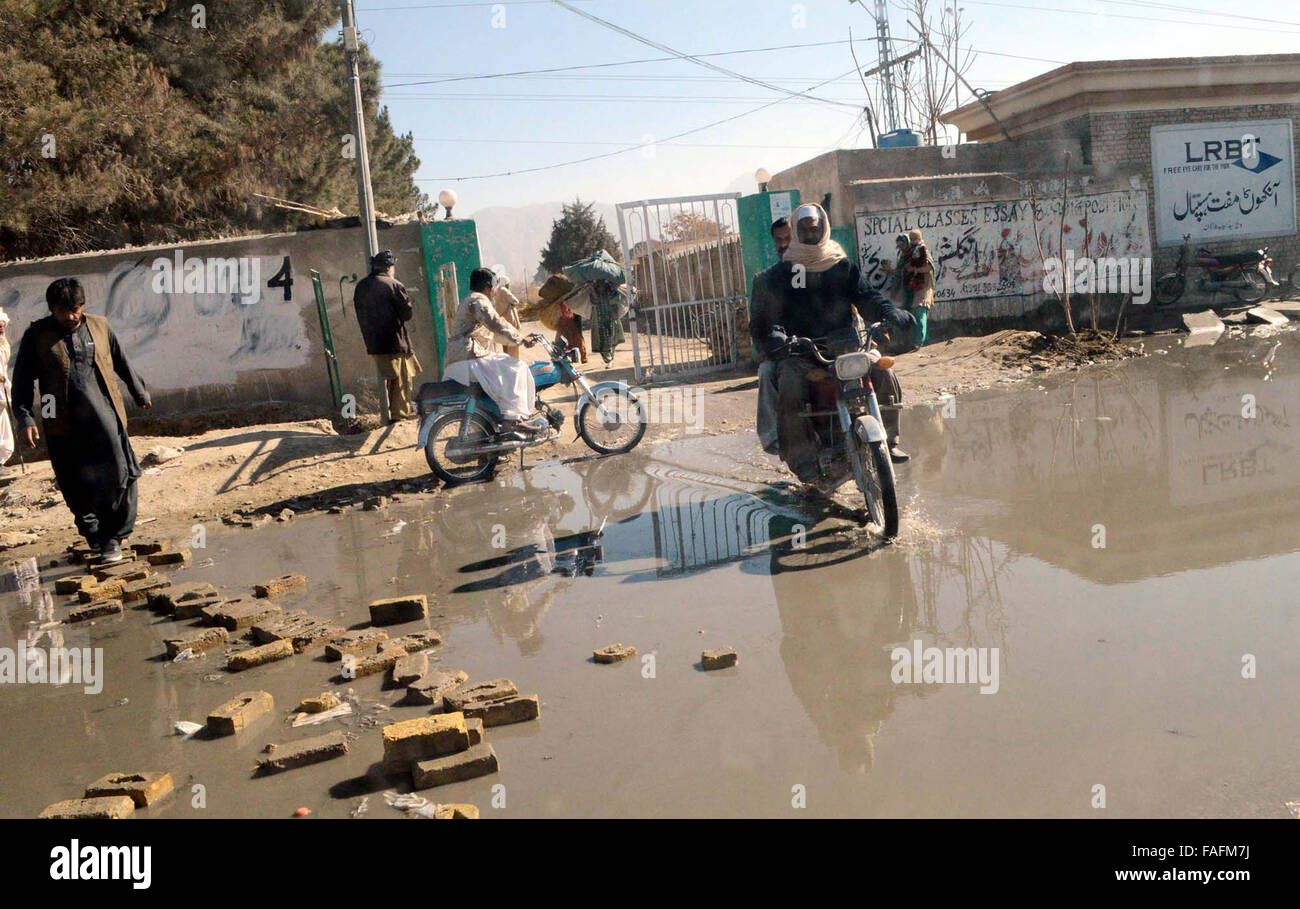 Commuters are passing through stagnant sewerage water which is creating an unhygienic atmosphere and showing the - Stock Image