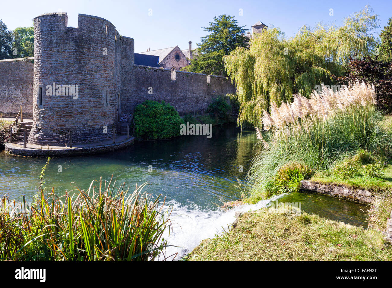 Water from the springs flowing into the moat surrounding the Bishops Palace in the cathedral city of Wells, Somerset - Stock Image