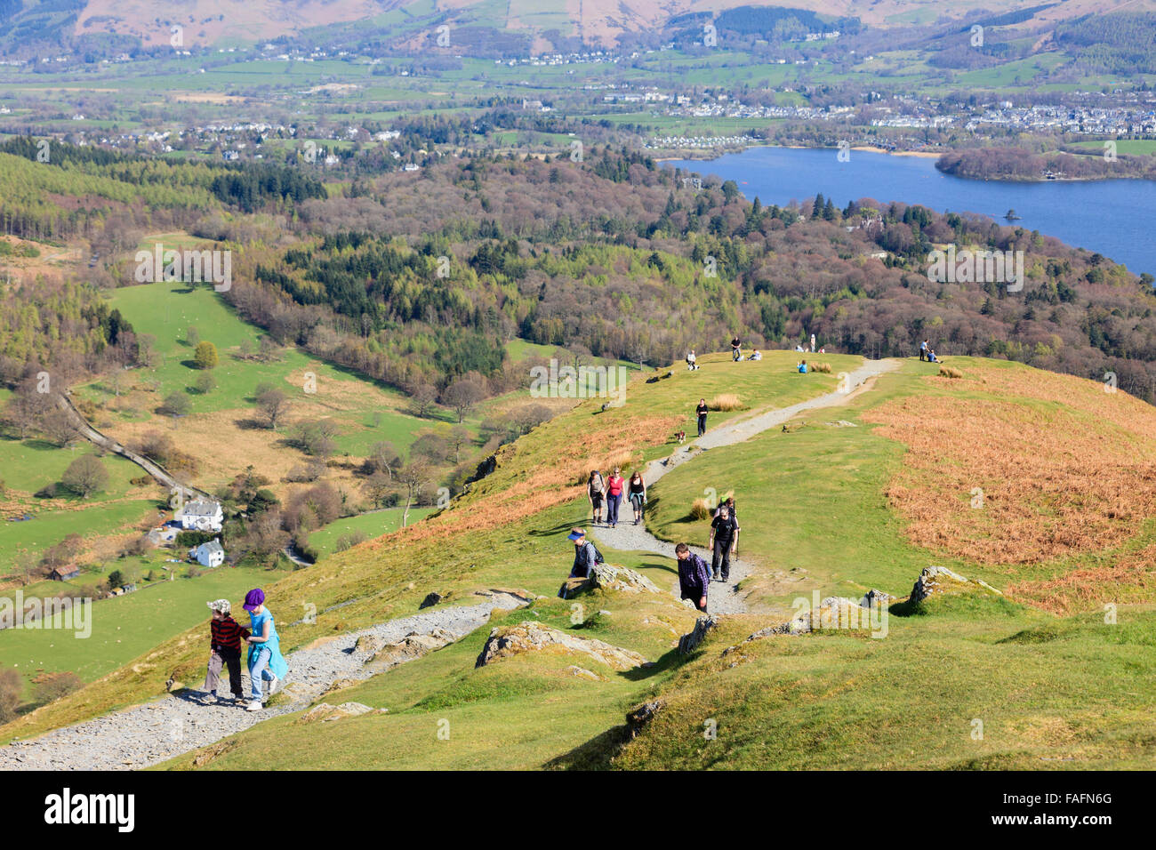People walking on path up Catbells with view to Derwent Water in Borrowdale beyond in the English Lake District. - Stock Image
