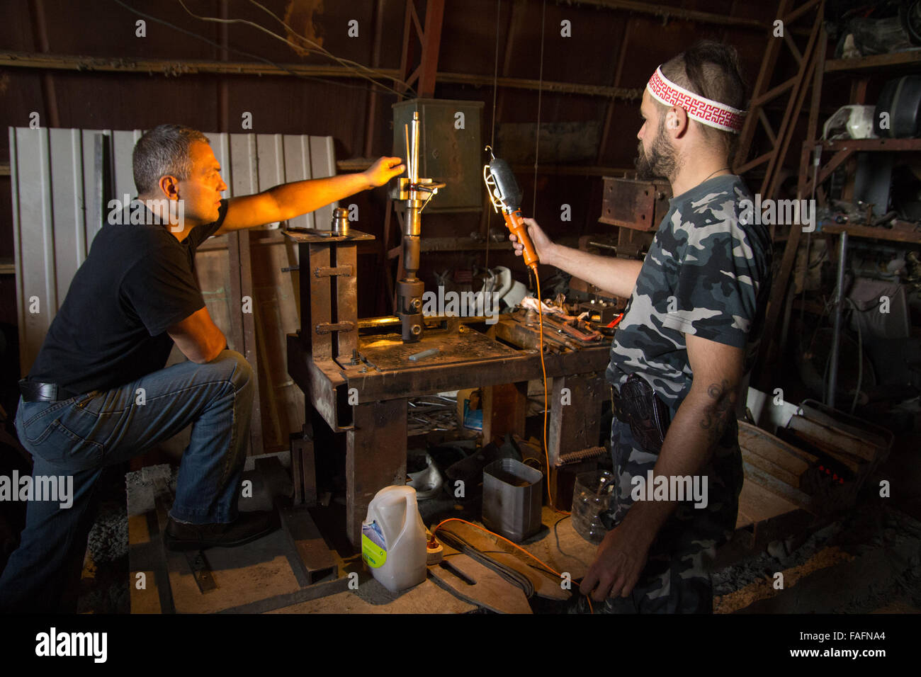 Vasily and Stanislav restoring assembly stand using German drawings at the Museum of Industrial Culture in Moscow. - Stock Image