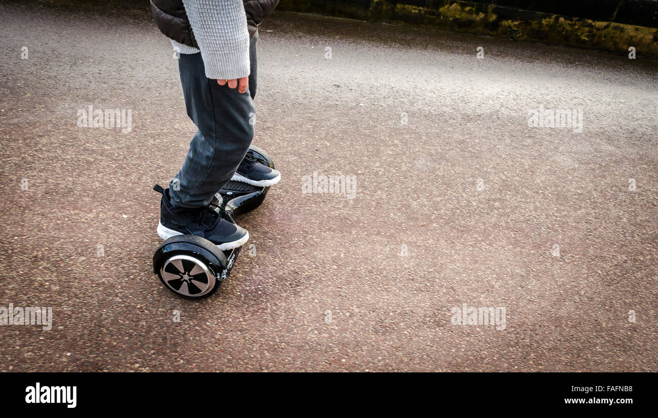 Person Riding a HoverBoard on a Public Footpath, They are now banned in all public places in the United Kingdom - Stock Image