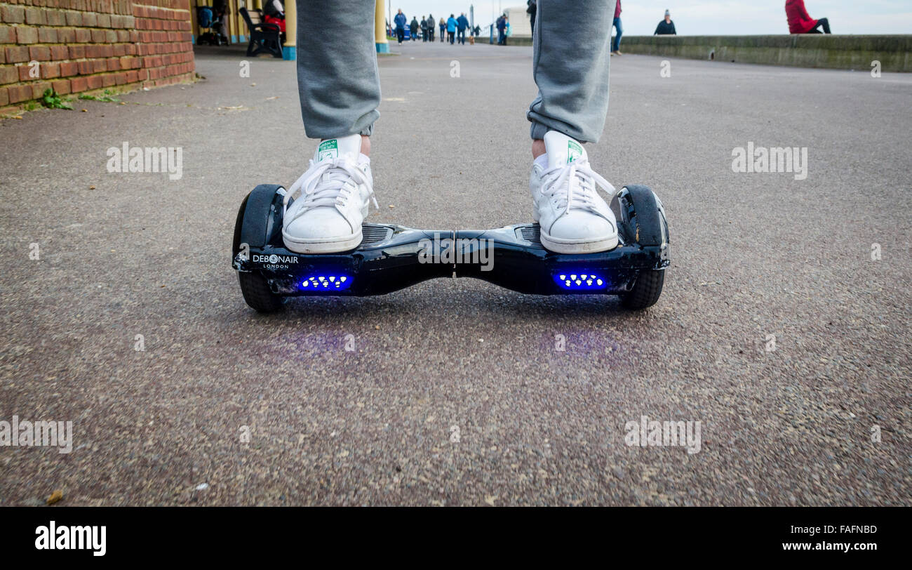 Person Riding a HoverBoard on a Public Footpath, They are now banned in all public places in the United Kingdom Stock Photo