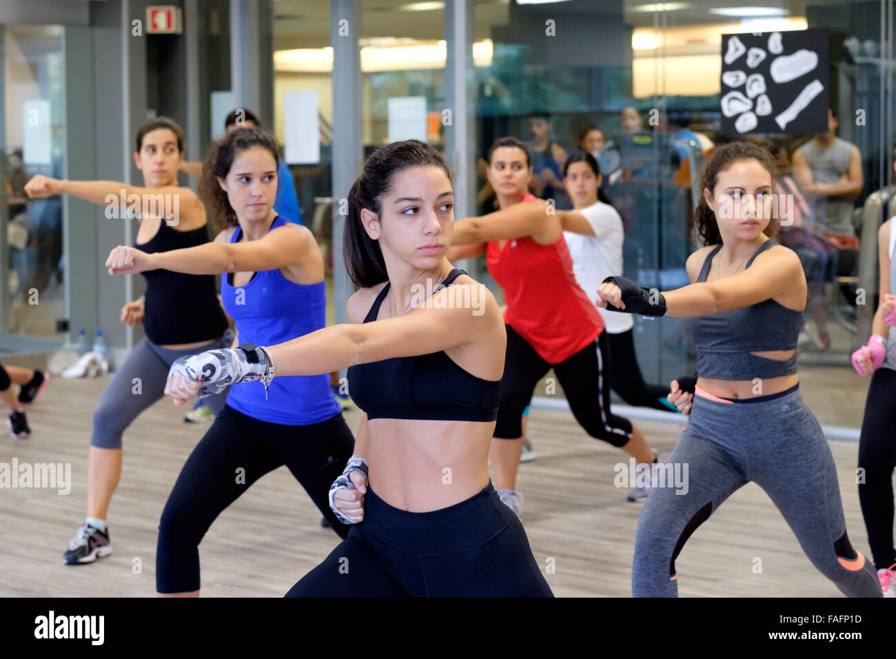 Young Women During Body Combat Fitness Class At The Gym