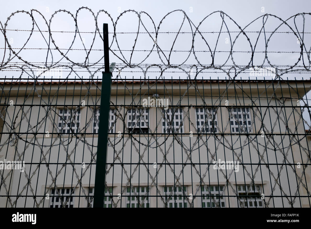 Prison walls with barbwire - Stock Image