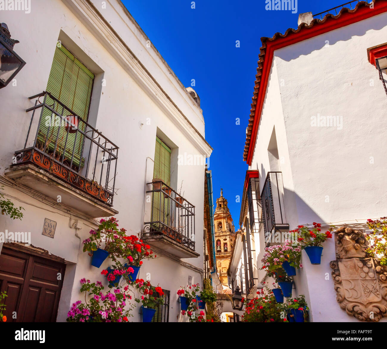 Flower Street Calleja de las Flores Old Torre del Alminar Bell Tower Mezquita Cordoba Andalusia Spain.  Mezquita Stock Photo