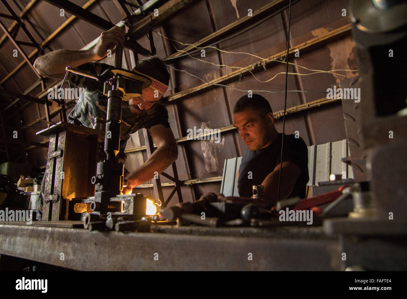 Vasily and Stanislav restoring assembly stand for German motorcycle at the Museum of Industrial Culture in Moscow. - Stock Image