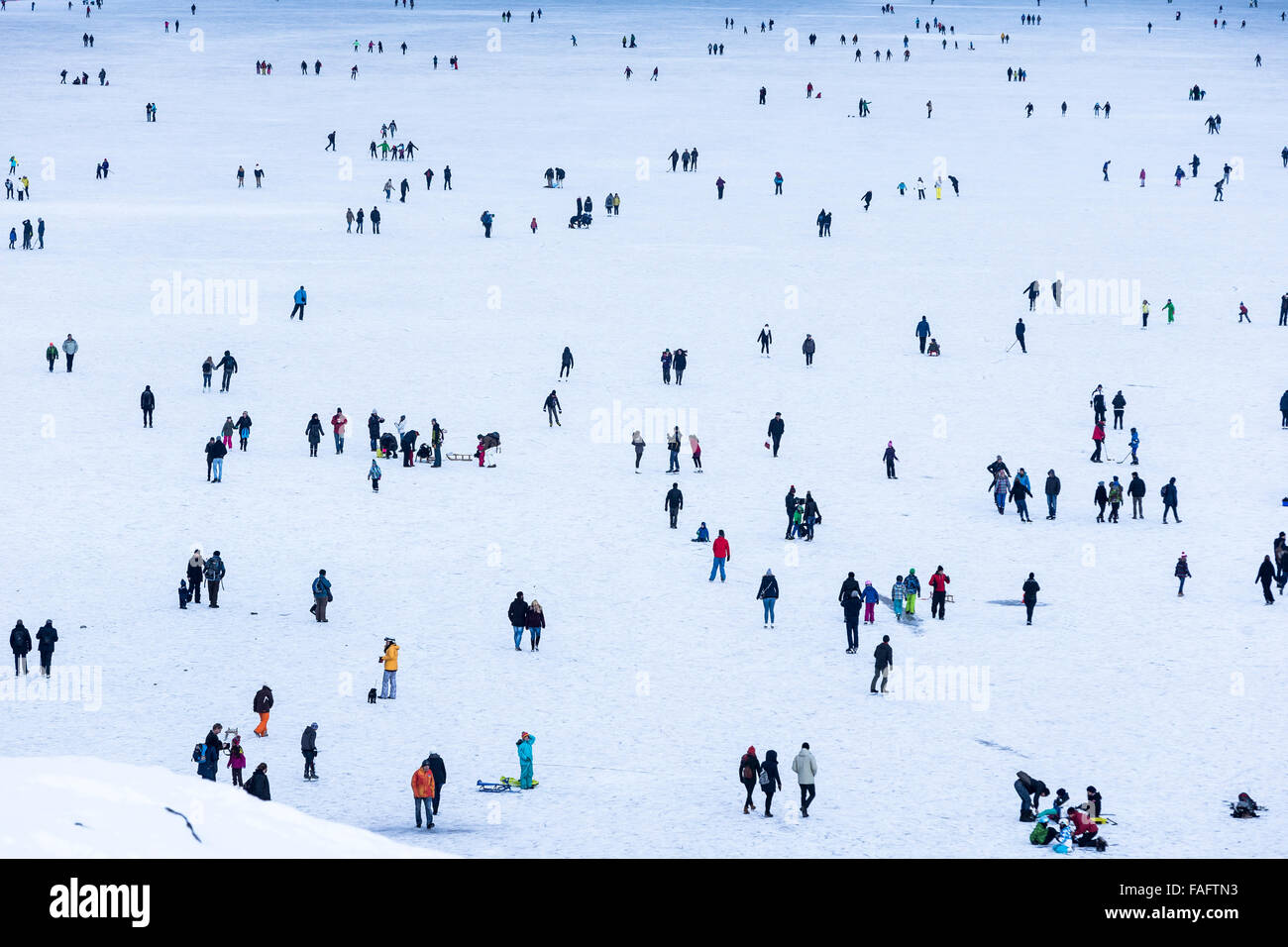 Kandersteg, Switzerland. 29th December, 2015. Ice skaters and walkers on the frozen lake Oeschinen 'Oeschinensee'. - Stock Image