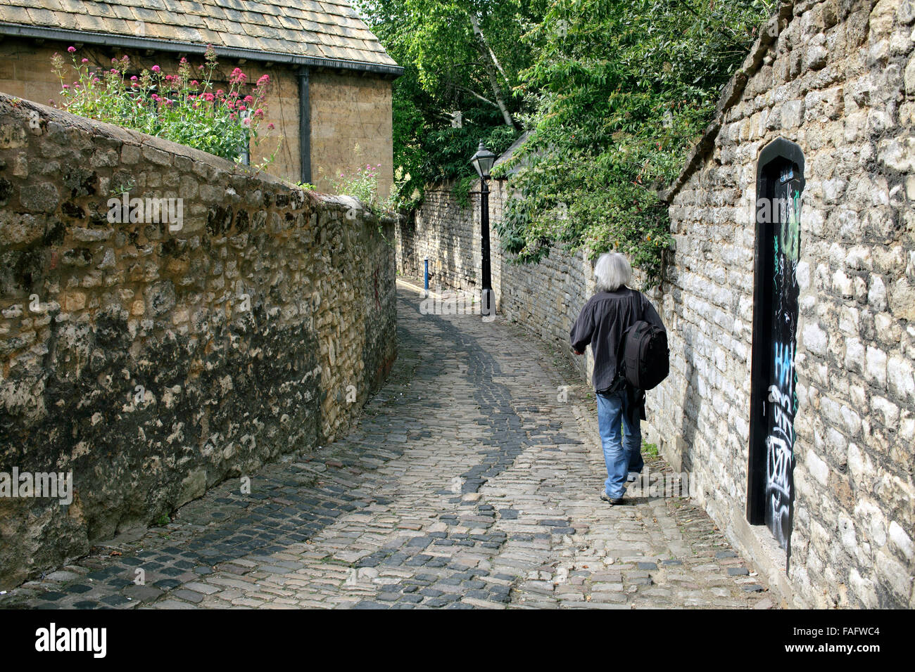 Exploring the back streets of Oxford: this is Bulwarks Lane which runs between New Road and George Street - in the - Stock Image