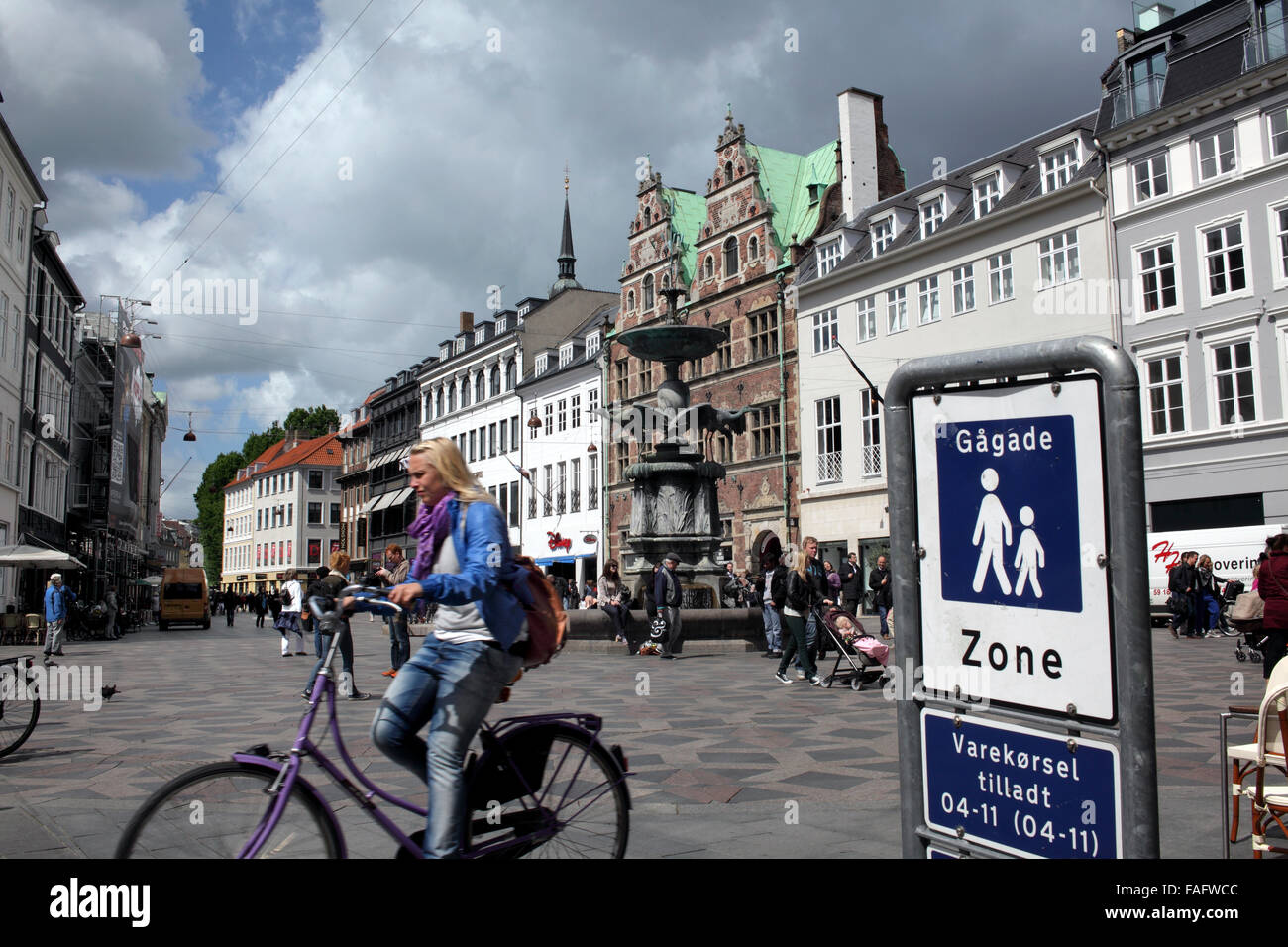 Pedestrian zone and cyclist in Amagertorv in the centre of Copenhagen, Denmark. - Stock Image