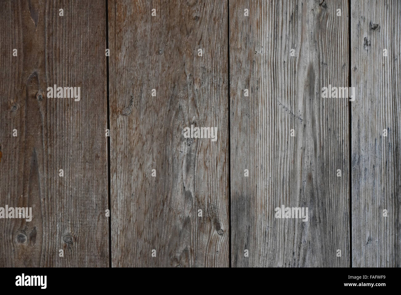 Old vintage rustic aged antique wooden sepia panel with vertical gaps, planks and chinks Stock Photo