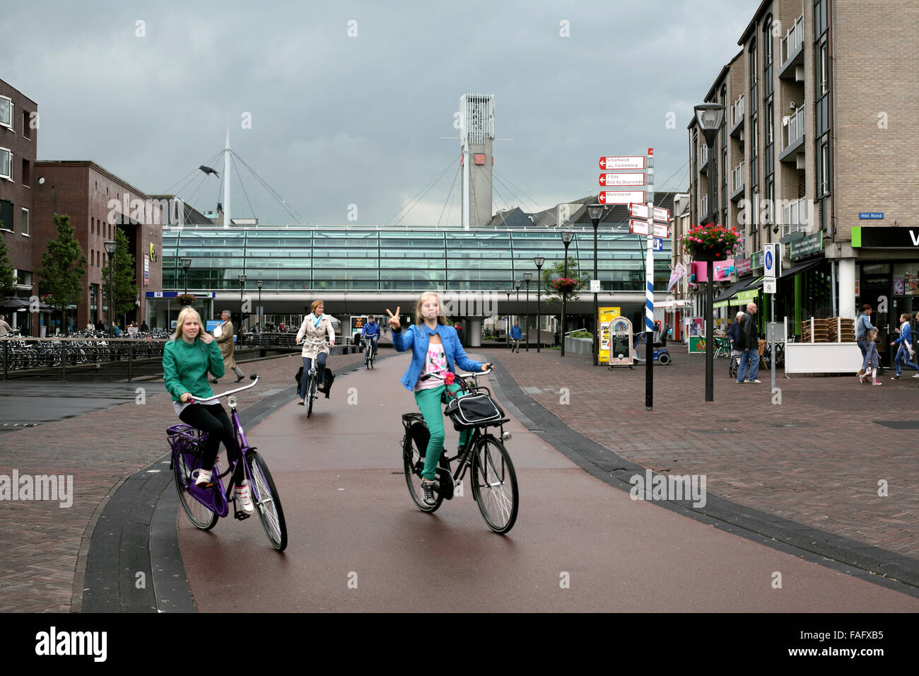 Cyclists in the traffic-free centre of Houten, a new town near Utrecht in The Netherlands. - Stock Image
