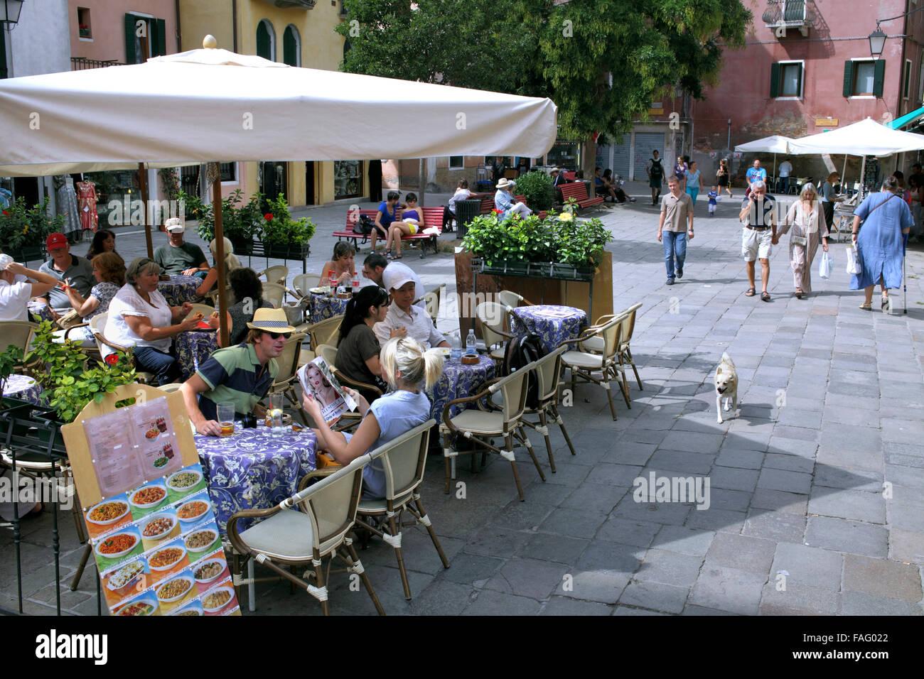 A restaurant in Campo Santa Maria Nova, a typical square  in car-free Venice. - Stock Image