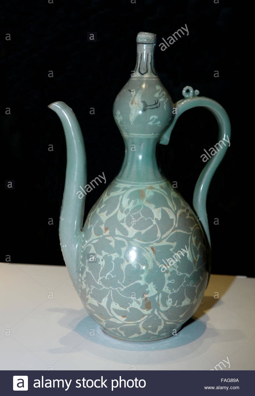 Gourd-shaped Celadon Ewer with Inlaid Peony Design Stock Photo