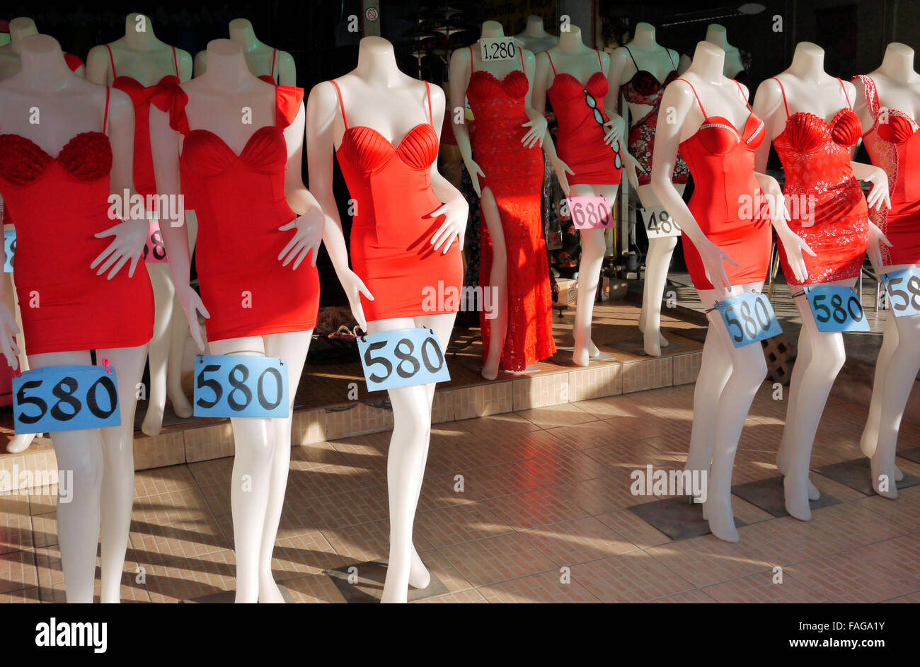 Cheap Red dresses for sale at one price of 8 Thai Baht displayed