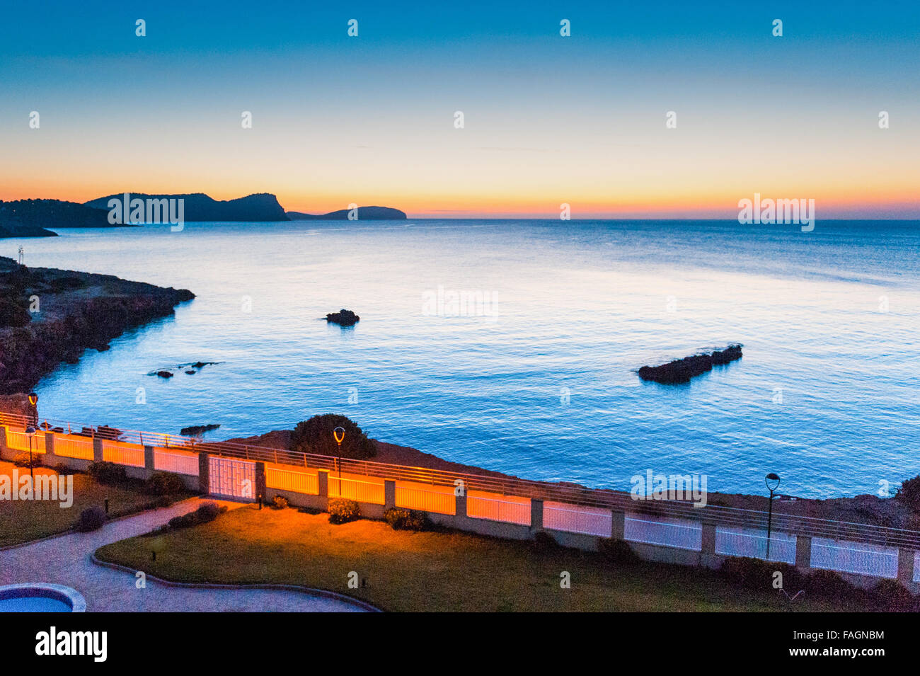 Sunrise over the calm beautiful water in Es Canar, Ibiza, part of the Balearic Islands in Spain,Europe. Stock Photo
