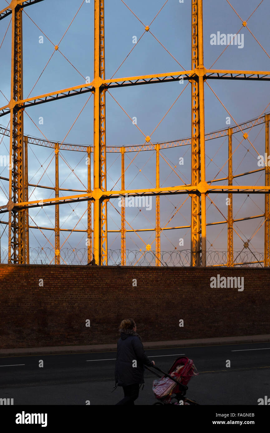 The Garston gas holders in dramatic spring light in Liverpool. These icons of industrial England are fast dissapearing - Stock Image