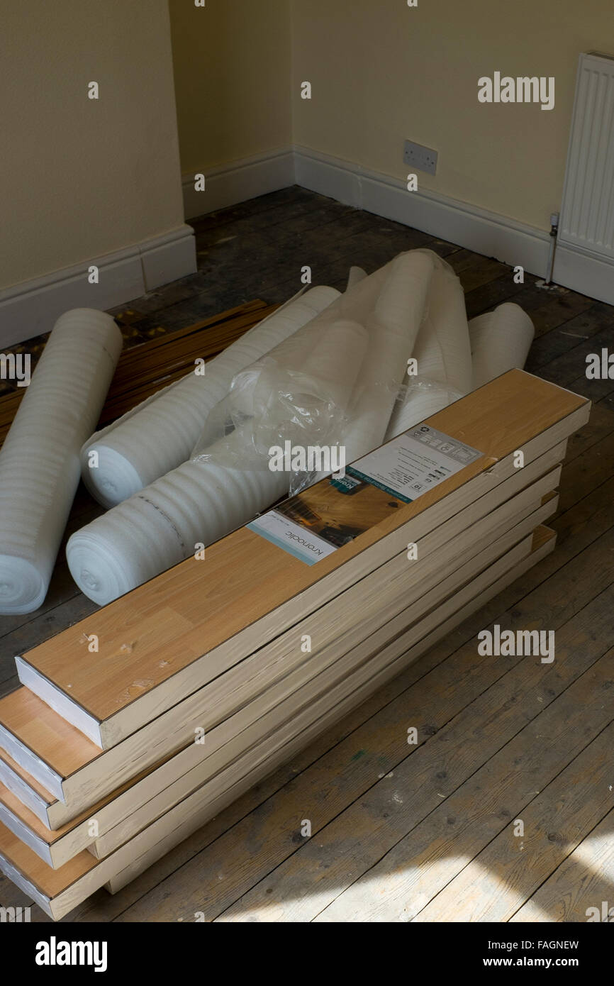 New Laminate flooring ina pile while renovating a house in Garston, Liverpool. Liverpool has seen influx of investment - Stock Image