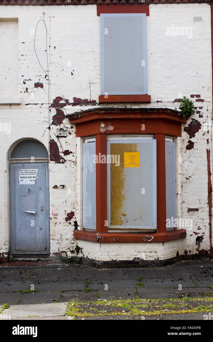 A boarded up house in Liverpool 8 has metal screens on doors and windows to deter vandals and thieves. Liverpool council owns & A boarded up house in Liverpool 8 has metal screens on doors and ...