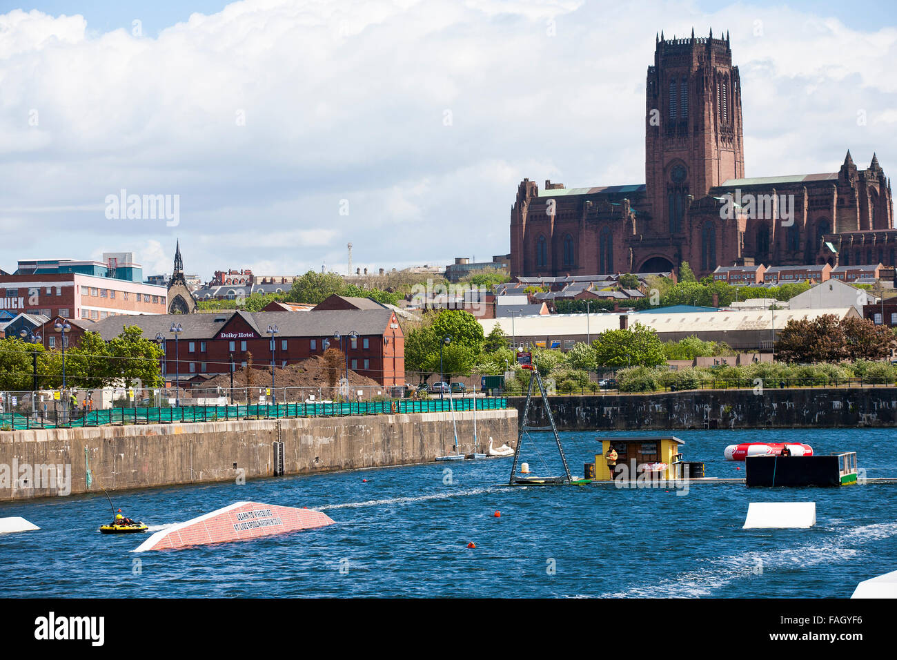 A wake boarding center and school in the Albert dock complex in the shadow of Liverpool's massive Anglican Cathedral. Stock Photo