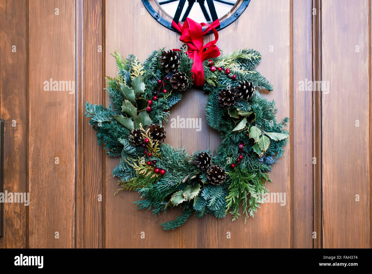 Christmas garland in front of a German home - Stock Image