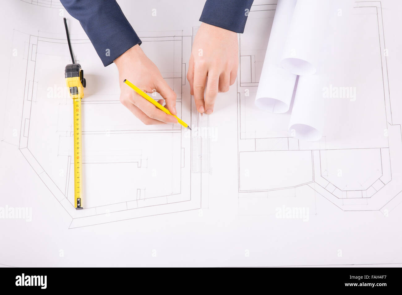 Male hands drawing an architecture project. - Stock Image
