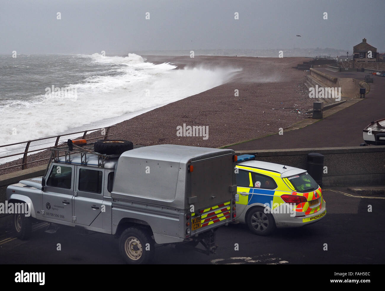Dorset, UK. 30th Dec, 2015. Environment Agency and Dorset Police on watch at Chesil Cove Portland this morning as - Stock Image