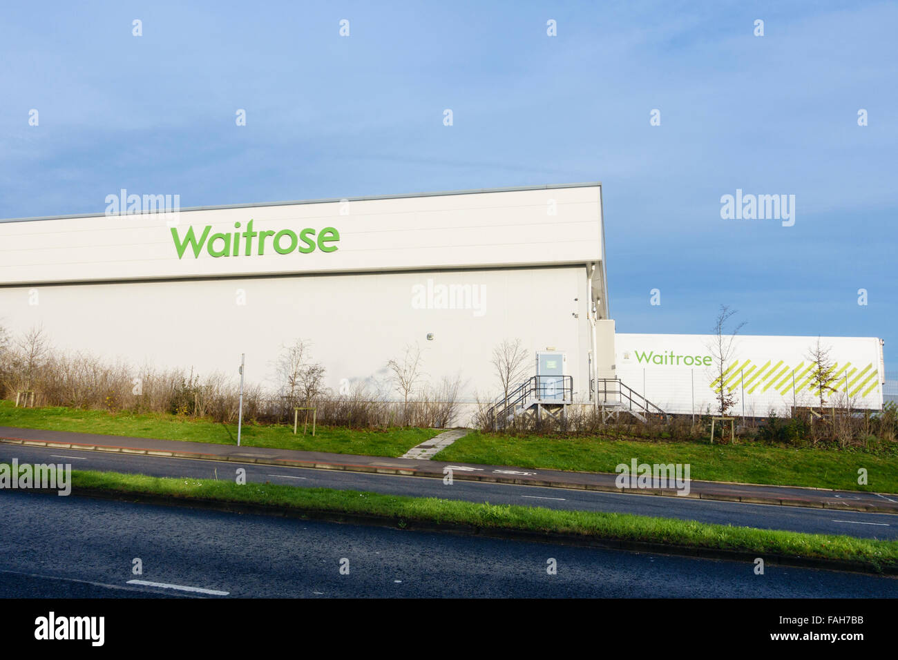 Waitrose Distribution Warehouse at headquarters with delivery lorries. Southern Industrial Area Bracknell Berkshire - Stock Image