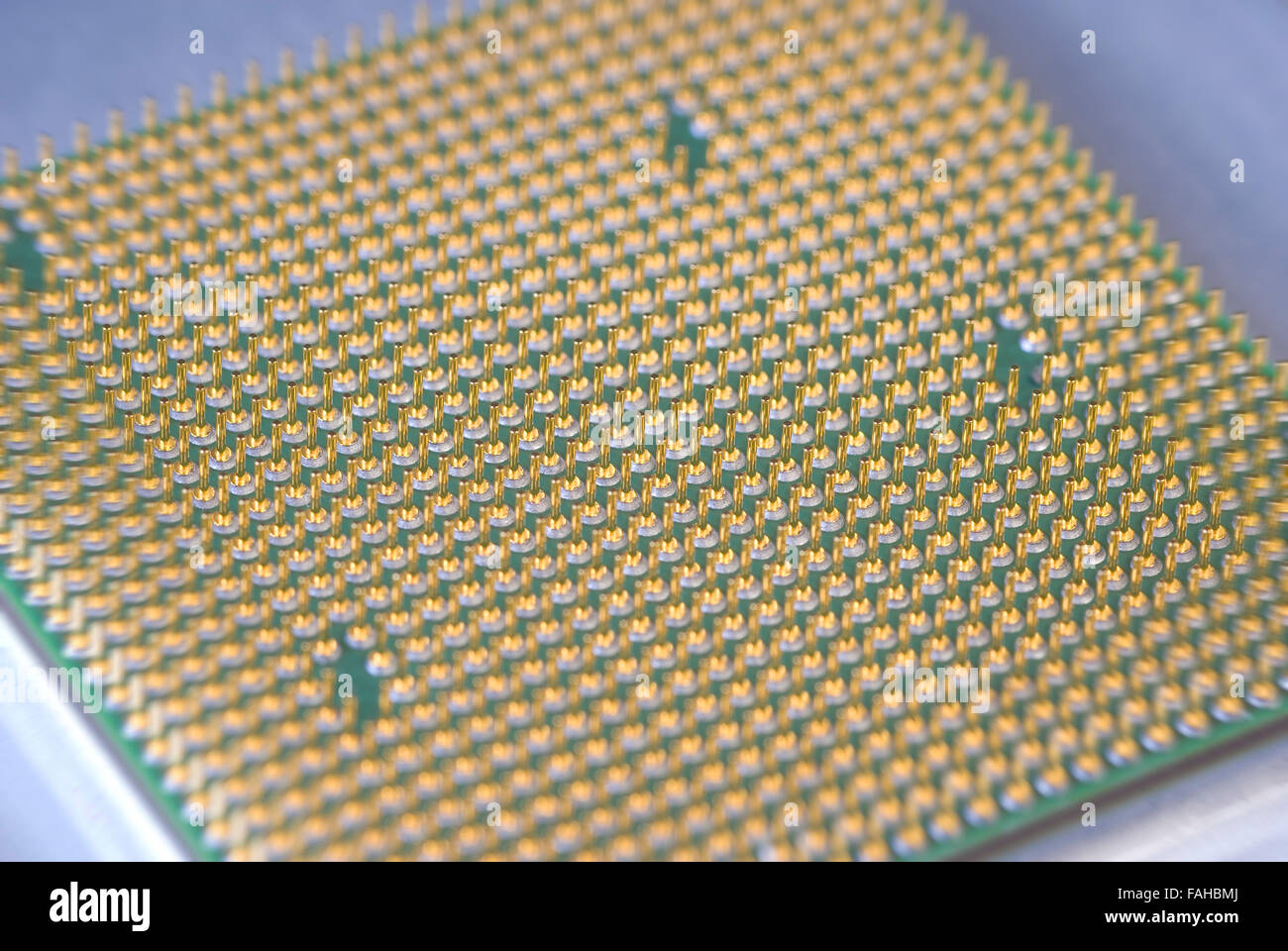 Gold Contacts on Computer CPU Chip - Stock Image