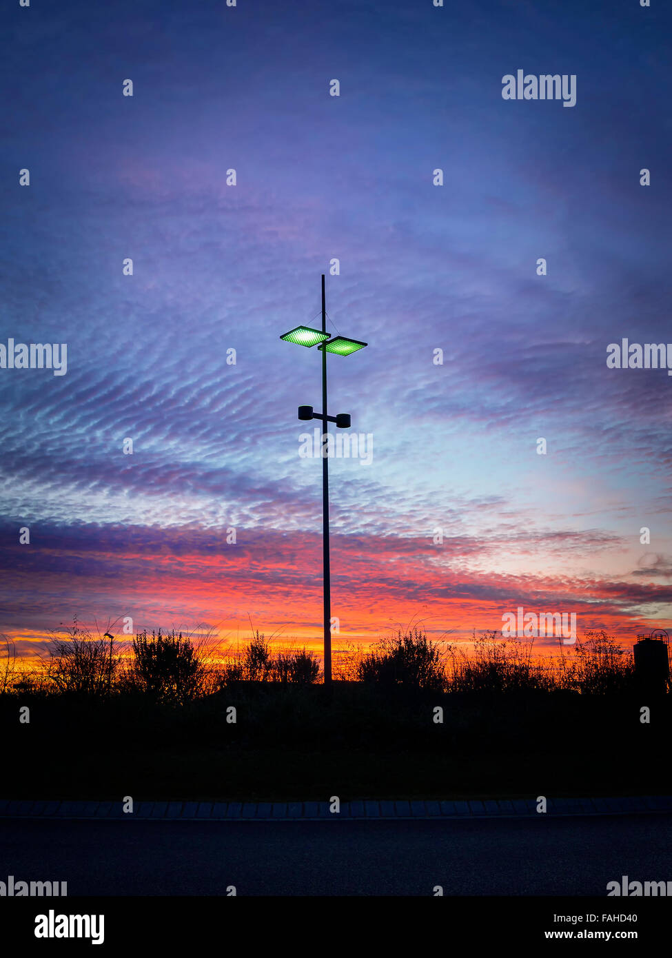 Image of a modern streetlamp at sunset - Stock Image