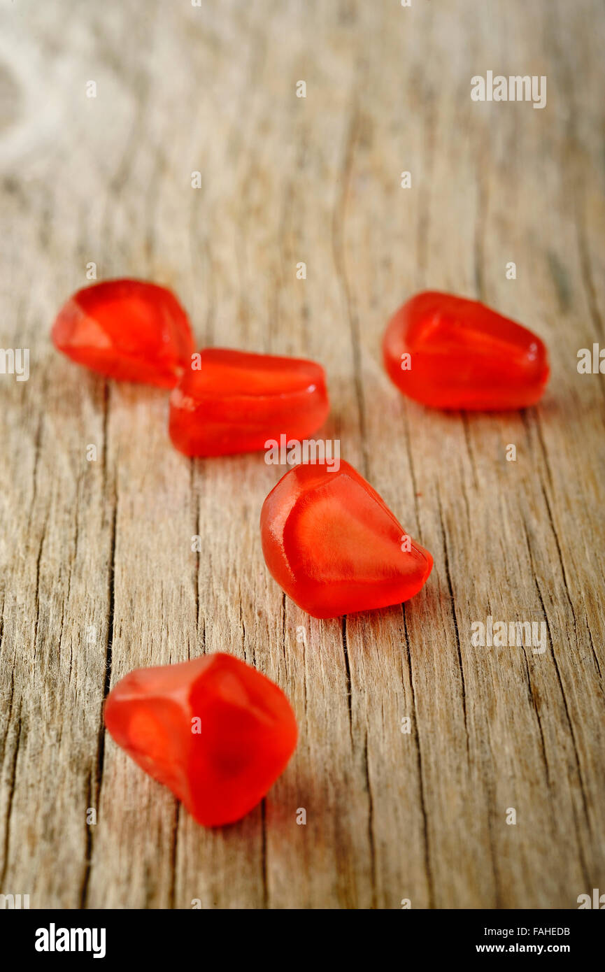 ripe pomegranate seeds on wooden table background Stock Photo
