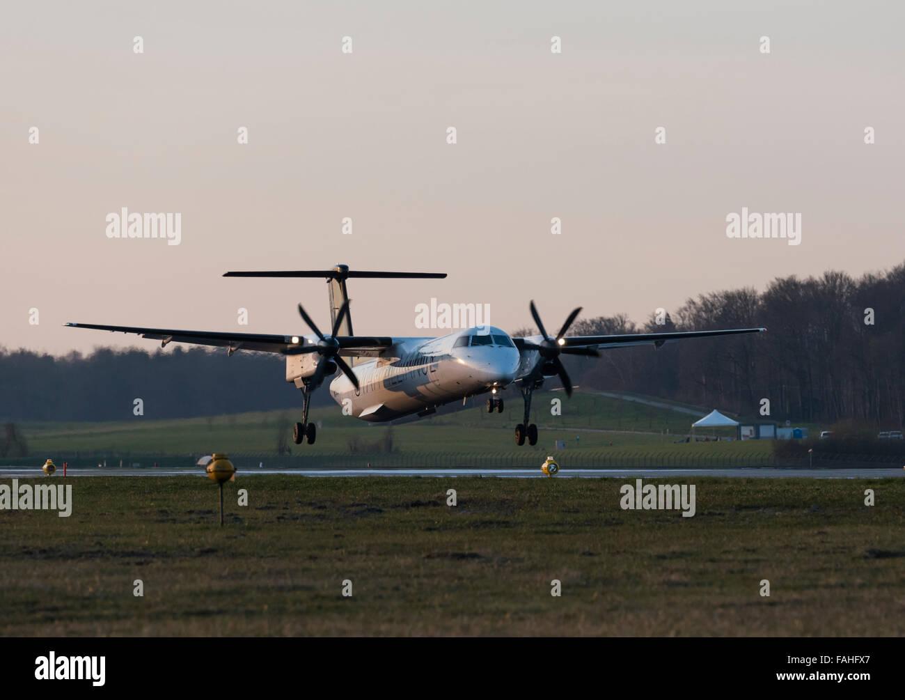 A turboprop passenger aircraft  is approaching runway14 of Zurich International airport (Kloten). - Stock Image