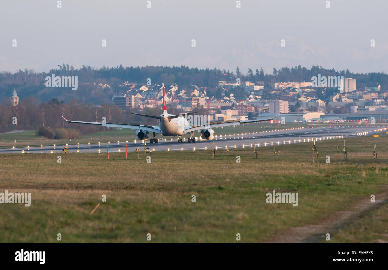 An Airbus A330 of Swiss International Air Line is decelerating with full thrust reversal after landing at Zurich - Stock Image