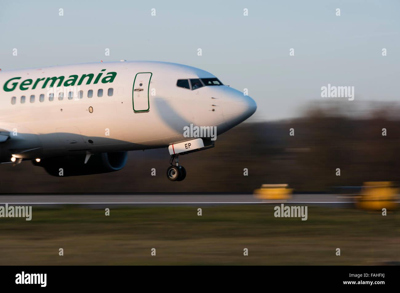 Landing Boeing 737 passenger aircraft of Germania airline at Zurich Kloten airport. - Stock Image