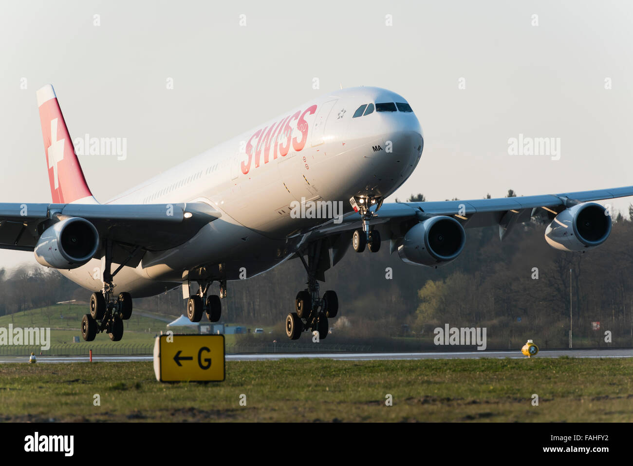 Landing Airbus A340 passenger aircraft of Swiss International Air Lines at Zurich Kloten airport. - Stock Image