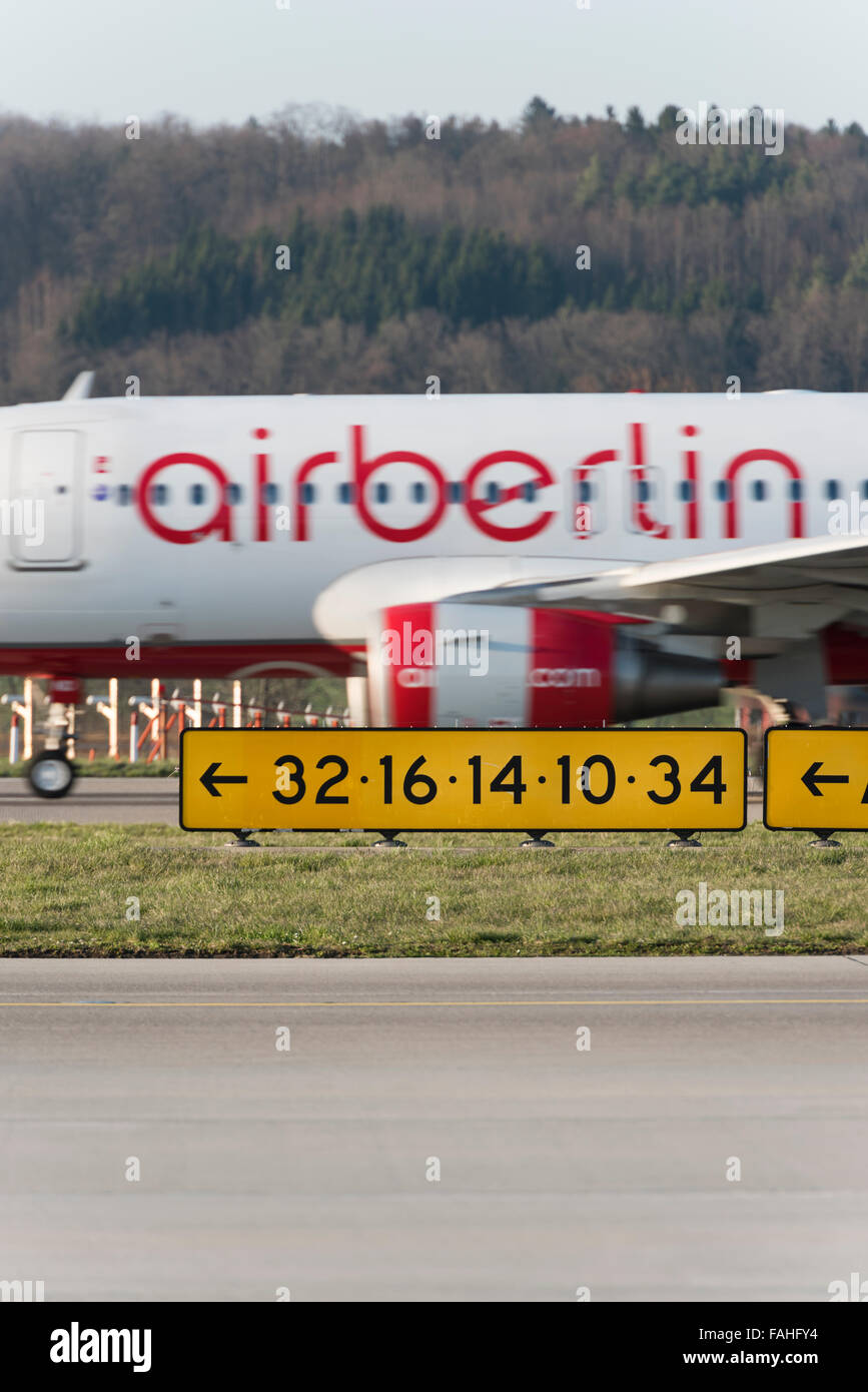 During takeoff from Zurich airport, an Airbus of German airline Air Berlin is passing behind the runway signalisation. Stock Photo