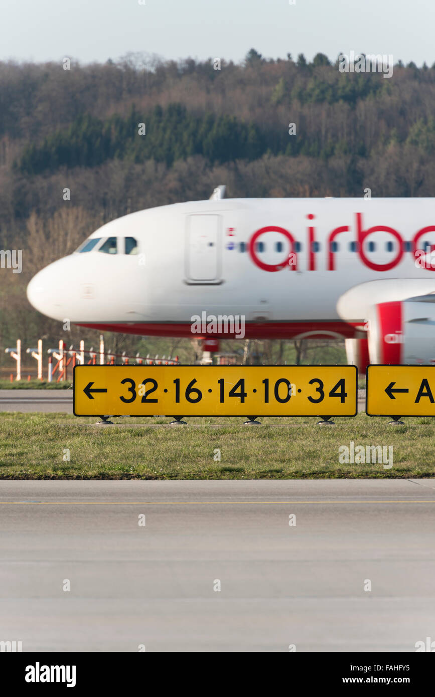 During takeoff from Zurich airport, an Airbus of German airline Air Berlin is passing behind the runway signalisation. - Stock Image