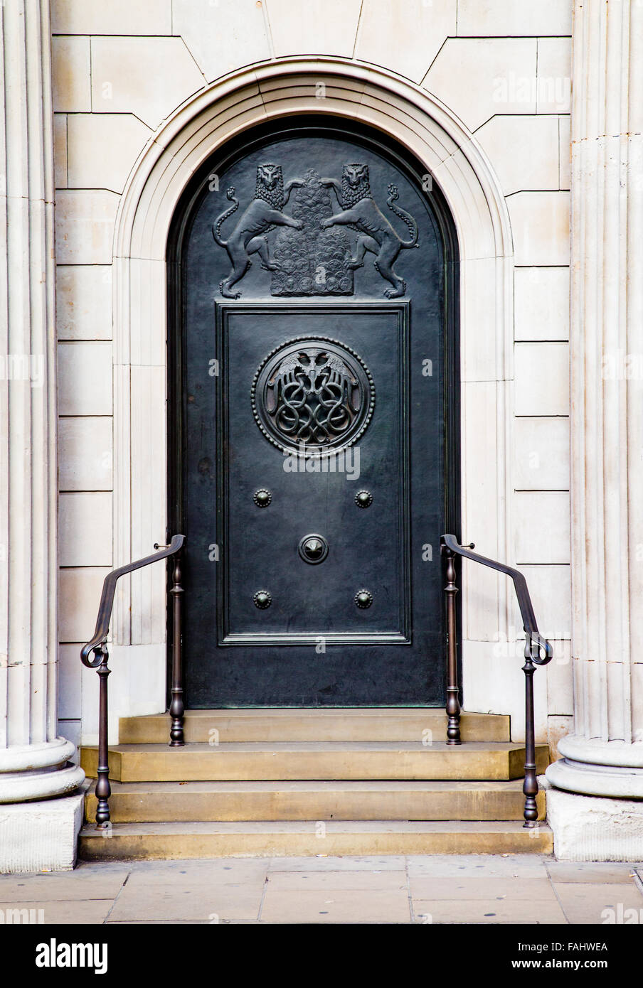 Bronze sculpted side door of the Bank of England building in Threadneedle Street in the City of London UK - Stock Image